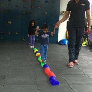 Coach teaching kid how to Balance