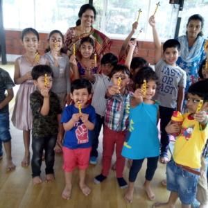 Children Showcasing their Bookmark Creation