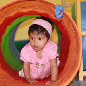 Child enjoying the Tunnel activity