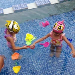 Kids Playing during the Toddler Parent Swimming Program