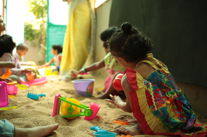 podar_jumbo_kids_playing-in_sandpit