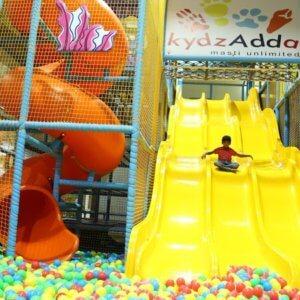 Kid enjoying the giant slide at Kydzadda Bannerghatta