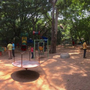 Defence Colony Park, Indiranagar, Bangalore is one the best parks to visit in Bangalore with your kids to enjoy the open spaces, rides, garden, swings, slides, rope bridgen adventure zone, cycling track, walking track