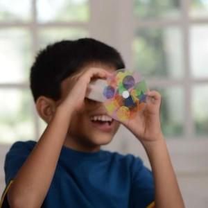 Small Brown Box Kid enjoying Kaleidoscope