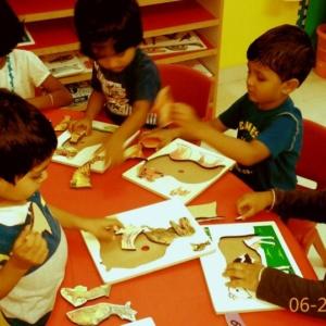 Kids Solving Puzzle