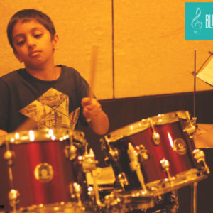 Ayaan learning drums at BlueTimbre