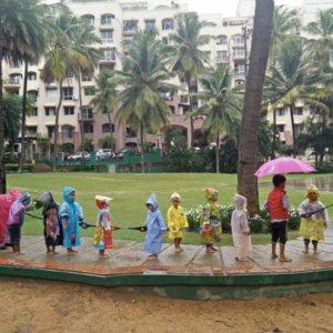 Children enjoying the rain at InBloom