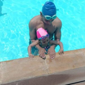 Father and Child at Nisha MIllet's Swimming Class