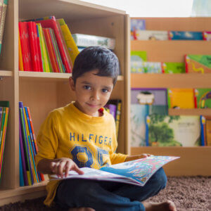 Child in the Library of The mUtha School