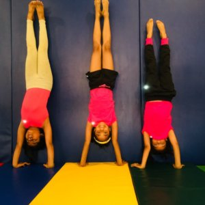 Kids doing Head Stand