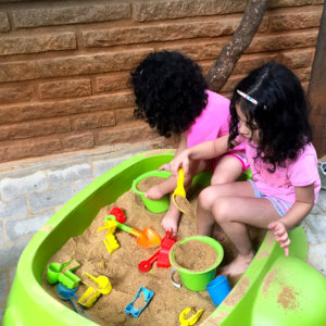 Kids Playing with sand in Small World Preschool