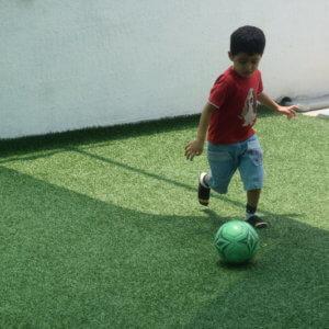 Kid playing football at Pep School V2