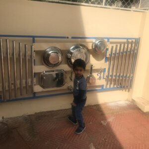 Child enjoying play equipment at Vedic Lore School