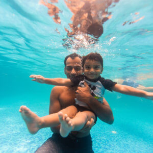 Father and Child enjoying swimming together