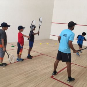 Coach Parmeet teaching Squash