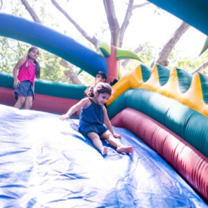 Kids having a good time at bouncy slide