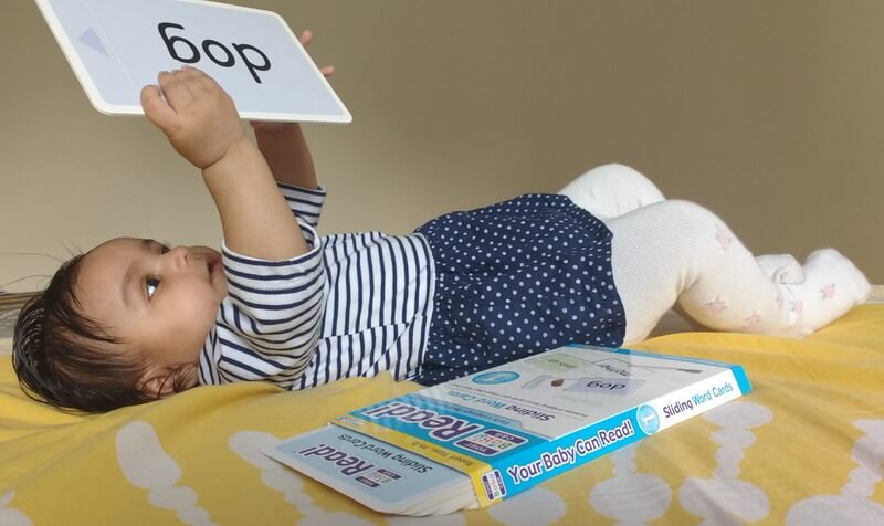 Child exploring cards from Your Baby Can