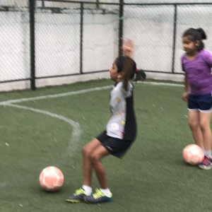 Girls enjoying football class