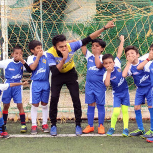 Students having fun with football coach