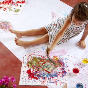 Child painting with Dabble Playart Toxin Free Finger Paints